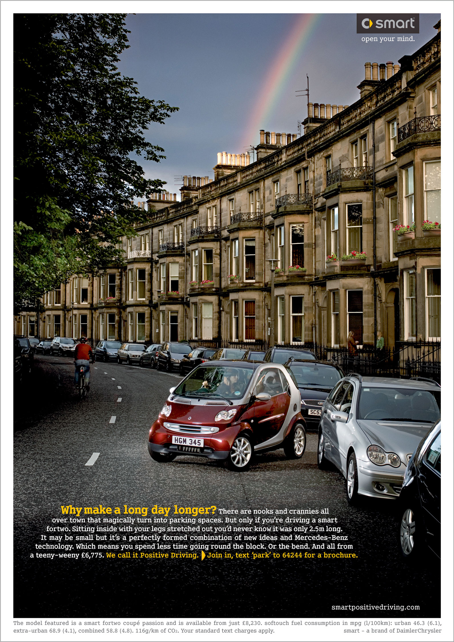 Red Smart car parking in traditional georgian cresent, edinburgh scotland with rainbow from chimney pots